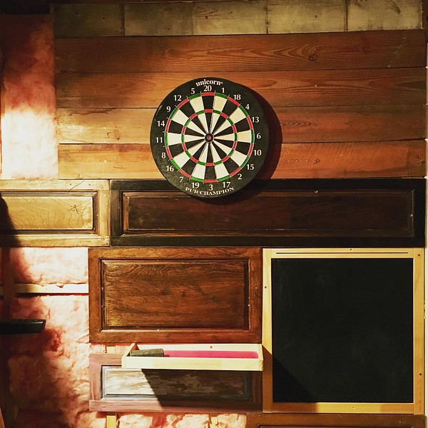 New darts wall is coming along. Ingredients include old bed slats, old kitchen cabinet doors and Henry's chalkboard. What will be next?? #diy #darts #reuse #repurpose