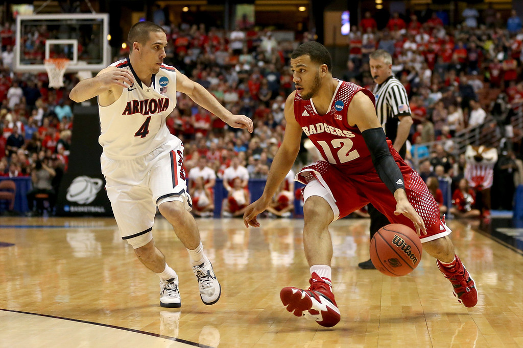 . Traevon Jackson #12 of the Wisconsin Badgers drives on T.J. McConnell #4 of the Arizona Wildcats in the first half during the West Regional Final of the 2014 NCAA Men\'s Basketball Tournament at the Honda Center on March 29, 2014 in Anaheim, California.  (Photo by Jeff Gross/Getty Images)