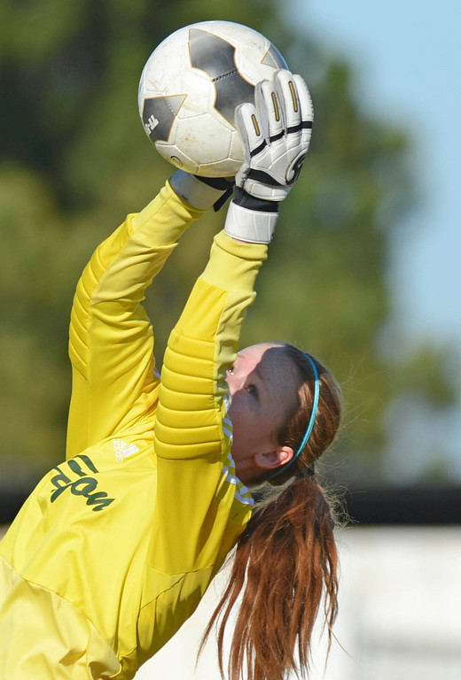 . Canyon keeper Meghan Kennedy (9) makes another save against Peninsula in a CIF SS Division II first round soccer game Thursday in Rolling Hills Estates. After Peninsula seemingly dominated most of the game, Canyon scored a goal in the final two minutes to win 1-0. 20130214 Photo by Steve McCrank / Staff Photographer