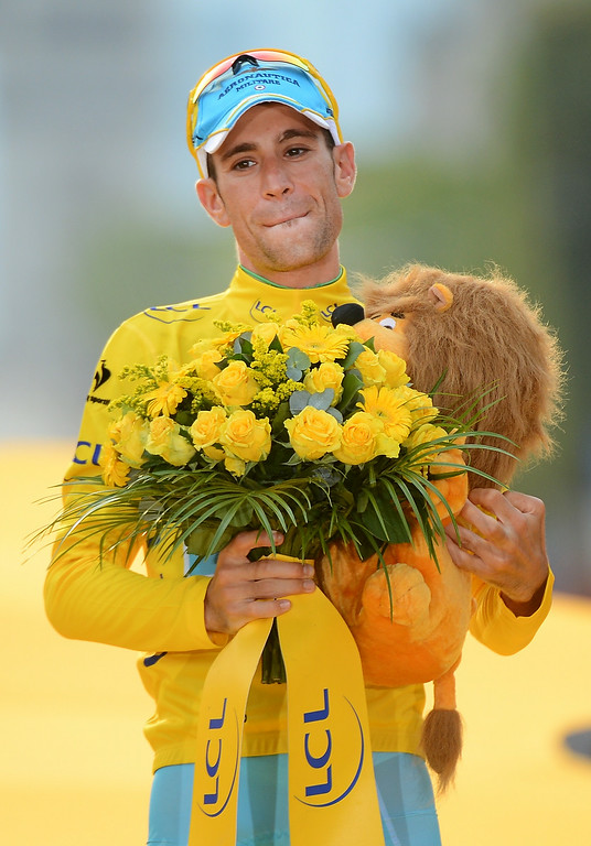 . Race winner Vincenzo Nibali of Italy, wearing the overall leader\'s yellow jersey,  celebrates on the podium of the Tour de France in Paris, France, Sunday, July 27, 2014. (AP Photo/Jerome Prevost, Pool)