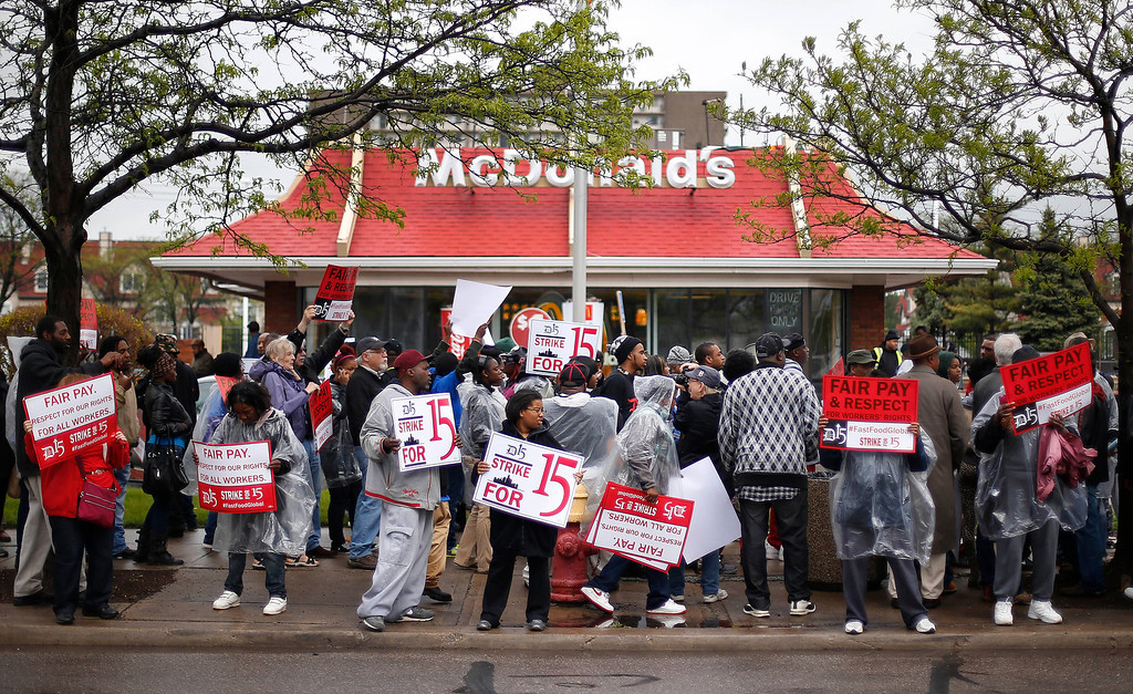 . Protesters picket for higher wages outside a McDonalds restaurant in Detroit Thursday, May 15, 2014.  (AP Photo/Paul Sancya)