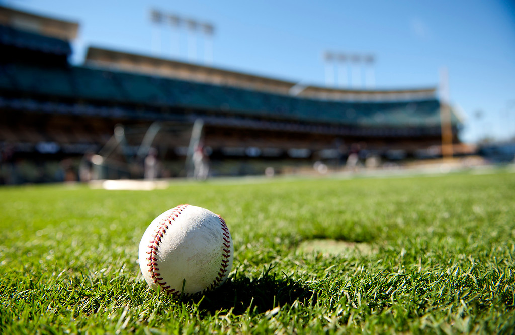 . A baseball sits on the field during batting practice before game 3 of the NLDS at Dodger Stadium Sunday, October 6, 2013. (Photo by Hans Gutknecht/Los Angeles Daily News)