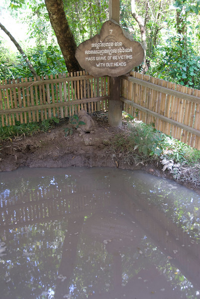 Another mass grave with sign at the Killing Fields in Phnom Penh, Cambodia
