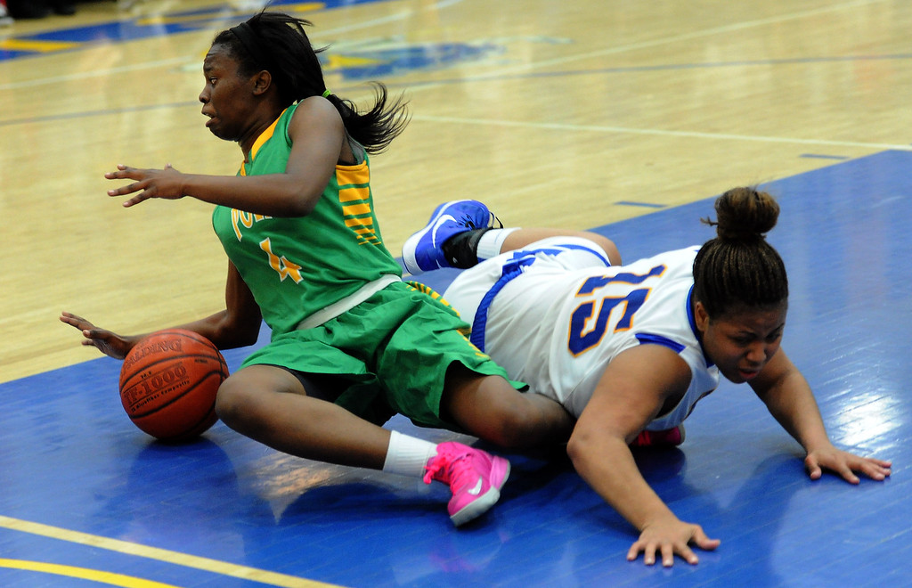 . Long Beach Poly\'s Tania Lamb (4) scrambles for the loose ball with Bishop Amat\'s Leeah Powell (15) in the second half of a CIF State Southern California Regional semifinal basketball game at Bishop Amat High School on Tuesday, March 12, 2013 in La Puente, Calif. Long Beach Poly won 52-34.  (Keith Birmingham Pasadena Star-News)