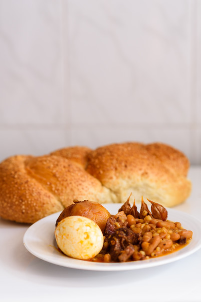 Challah Shabbat Bread And Hamin Or Cholent In Hebrew - Sabbath Traditional Food On White Table In Th