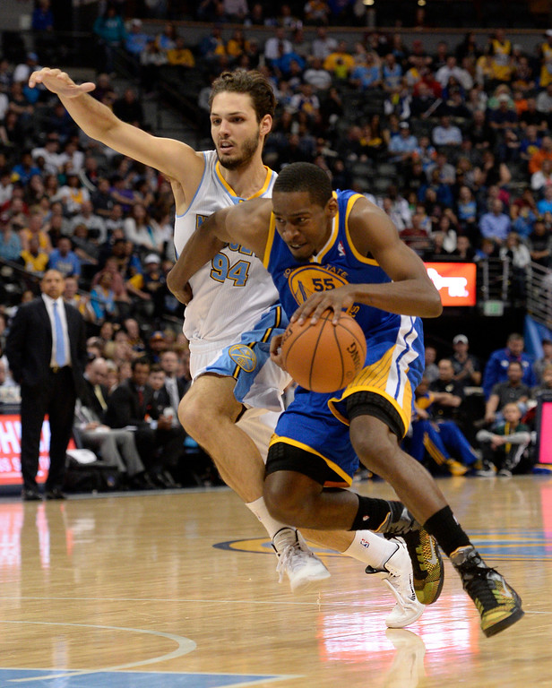 . DENVER, CO - APRIL 16: Golden State Warriors guard Jordan Crawford (55) drives past Denver Nuggets guard Evan Fournier (94) during the fourth quarter April 16, 2014 at Pepsi Center. Golden State Warriors defeated the Denver Nuggets 116-112. (Photo by John Leyba/The Denver Post)