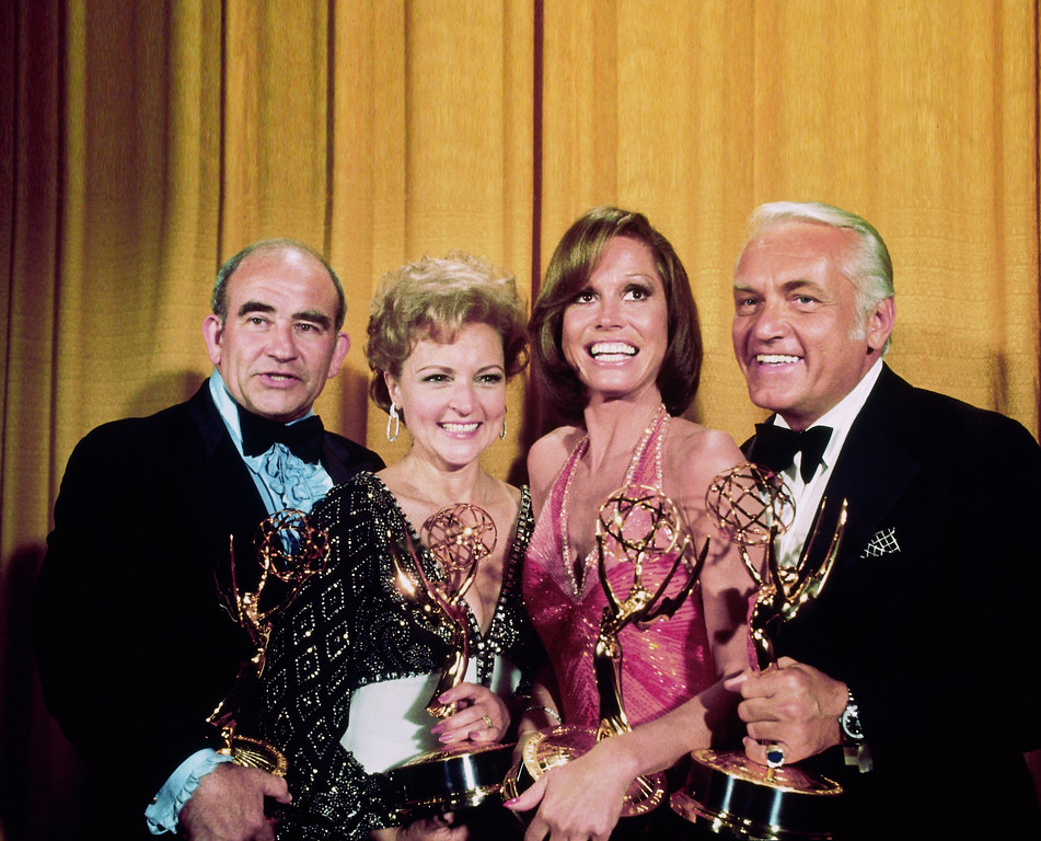 ". LOS ANGELES, CA - MAY 17, 1976: (L-R) ""The Mary Tyler Moore Show\"" co-stars - Ed Asner, Betty White, Mary Tyler Moore and Ted Knight - all won awards at the Academy of Television Arts & Sciences 28th Annual Primetime Emmy Awards held at the Shubert Theatre on May 17, 1976 in Los Angeles, California. (Photo by TVA/PictureGroup/Invision for the Academy of Television Arts & Sciences/AP Images)"