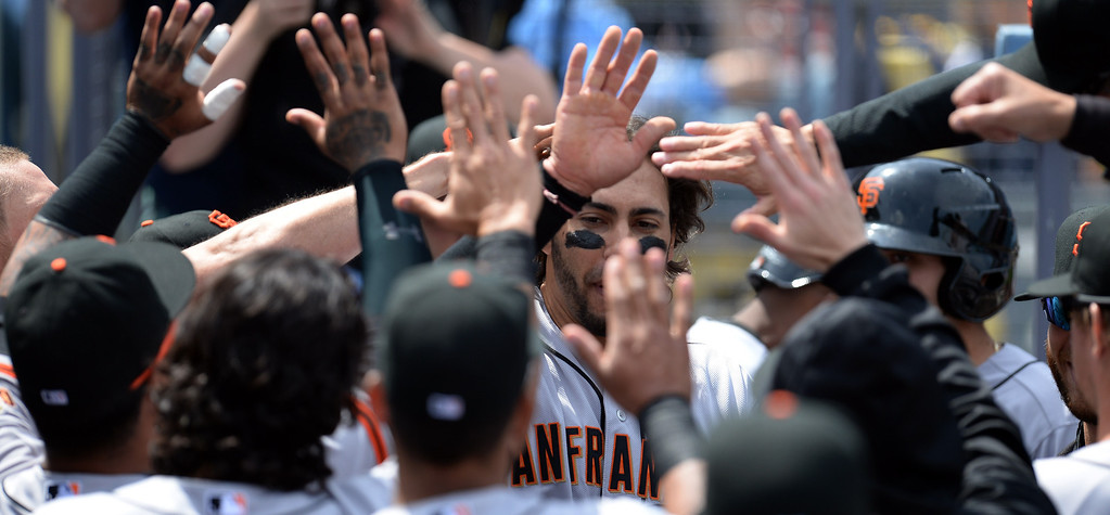 . The Giants\' Michael Morse #38 enters the dugout after scoring in the 1st inning against the Dodegrs at Dodger Stadium Friday 4, 2014. The Giants beat the Dodgers 8-4.  (Photo by Hans Gutknecht/Los Angeles Daily News)