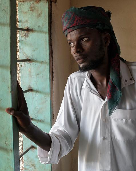 Muslim man inside a tiny mosque somewhere in northern Tanzania.  Tanzania, 2019