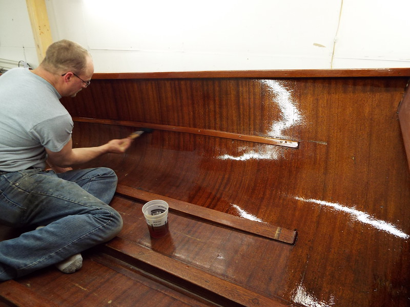 Varnish being applied.