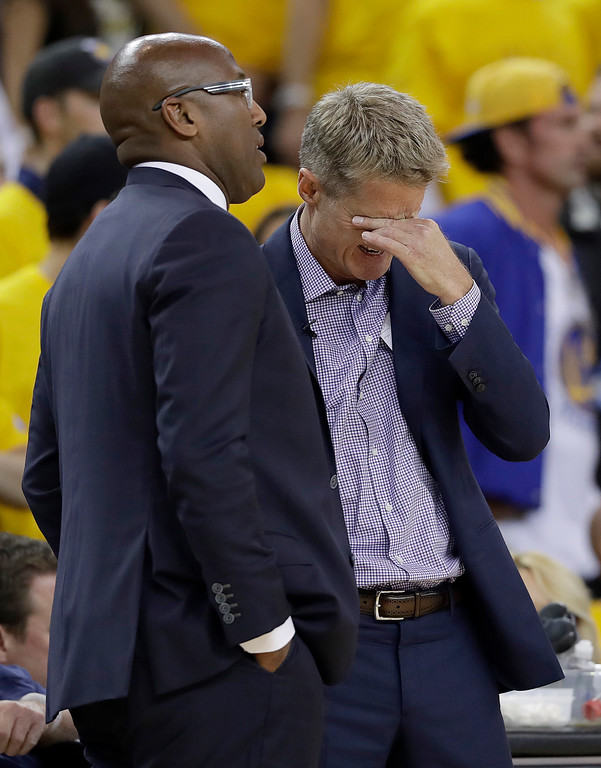 . Golden State Warriors head coach Steve Kerr, right, reacts next to Mike Brown during the first half of Game 2 of basketball\'s NBA Finals against the Cleveland Cavaliers in Oakland, Calif., Sunday, June 4, 2017. (AP Photo/Marcio Jose Sanchez)