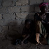 Liliane Mwayuma, 36, and her 3-year-old son Yvon shelter in the Church of Light