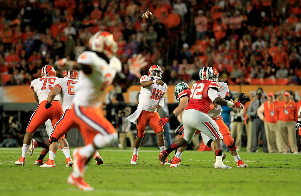. MIAMI GARDENS, FL - JANUARY 03: Tajh Boyd #10 of the Clemson Tigers throws a touchdown pass to Sammy Watkins #2 in the first quarter against the Ohio State Buckeyes during the Discover Orange Bowl at Sun Life Stadium on January 3, 2014 in Miami Gardens, Florida.  (Photo by Chris Trotman/Getty Images)