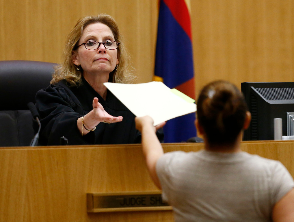 . Judge Sherry Stephens is handed the decision which found Jodi Arias guilty of first-degree murder in the gruesome killing of her one-time boyfriend, Travis Alexander, in their suburban Phoenix home, Wednesday, May 8, 2013, at Maricopa County Superior Court in Phoenix.  (AP Photo/The Arizona Republic, Rob Schumacher, Pool)