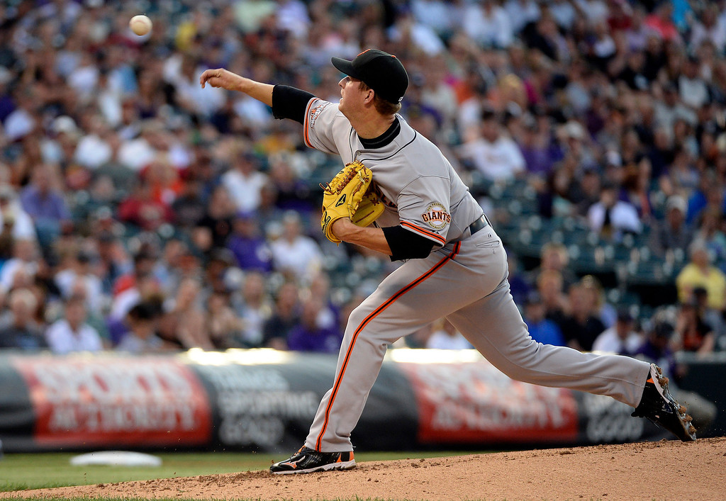 . Matt Cain (18) of the San Francisco Giants delivers a pitch in during the second inning against the Colorado Rockies May 16, 2013 at Coors Field. (Photo By John Leyba/The Denver Post)