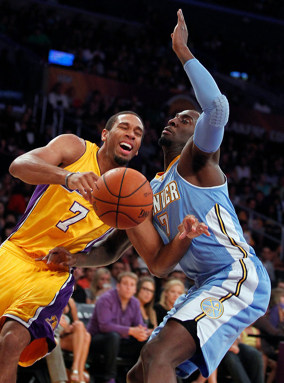 . Los Angeles Lakers guard Xavier Henry, left, has the ball knocked away by Denver Nuggets forward J.J. Hickson during an NBA preseason basketball game Sunday, Oct. 6, 2013 in Los Angeles. (AP Photo/Alex Gallardo)