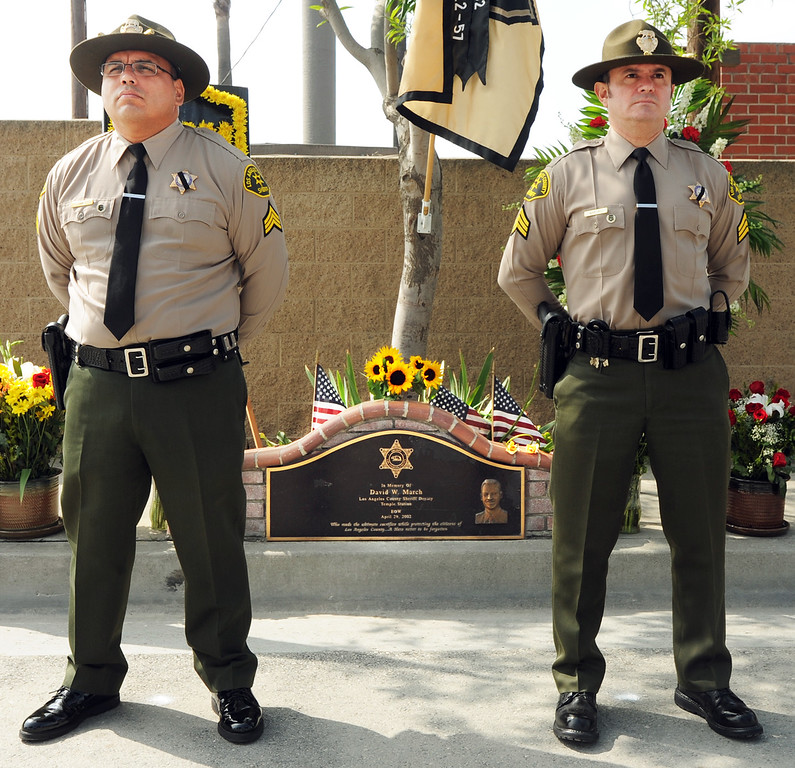. Deputies Sgt. Steven Ruiz, left, and Sgt. Mike Mrtinez Monday, April 29, 2013, once again stood in a 24-hour vigil on the site at Live Oak Avenue, near Peck road in Irwindale, where fellow Los Angeles County Deputy David March was gunned down during a traffic stop 11 years ago. March, 33, of Saugus was assigned to the Sheriff�s Temple Station when he was killed in the line of duty on April 29, 2002, on Live Oak Avenue near Peck Road in Irwindale. He was a 7-year veteran of the sheriff�s department and is survived by his wife, Teri, as well as a step-daughter. He was shot to death by Jorge Arroyo Garcia, also known as Armando Garcia, during what began as a routine traffic stop. Garcia, who was arrested in Mexico in 2006, was extradited to the U.S. to face trial in early 2007 and is now serving a life sentence in prison. When he was returned to the U.S. to face justice, fellow deputies cuffed him with March�s handcuffs. Every year since March�s death, fellow deputies have honored him with a 24-hour honor guard at the scene of his slaying, near a permanent plaque commemorating the sacrifice of the fallen deputy(SGVN/Photo by Walt Mancini)  Deputies Sgt. Steven Ruiz, left, and Sgt. Mike Mrtinez Monday, April 29, 2013, once again stood in a 24-hour vigil on the site at Live Oak Avenue, near Peck road in Irwindale, where fellow Los Angeles County Deputy David March was gunned down during a traffic stop 11 years ago. March, 33, of Saugus was assigned to the Sheriff�s Temple Station when he was killed in the line of duty on April 29, 2002, on Live Oak Avenue near Peck Road in Irwindale. He was a 7-year veteran of the sheriff�s department and is survived by his wife, Teri, as well as a step-daughter. He was shot to death by Jorge Arroyo Garcia, also known as Armando Garcia, during what began as a routine traffic stop. Garcia, who was arrested in Mexico in 2006, was extradited to the U.S. to face trial in early 2007 and is now serving a life sentence in prison. When he was returned to the U.S. to face justice, fellow deputies cuffed him with March�s handcuffs. Every year since March�s death, fellow deputies have honored him with a 24-hour honor guard at the scene of his slaying, near a permanent plaque commemorating the sacrifice of the fallen deputy(SGVN/Photo by Walt Mancini)  Deputies Sgt. Steven Ruiz, left, and Sgt. Mike Mrtinez Monday, April 29, 2013, once again stood in a 24-hour vigil on the site at Live Oak Avenue, near Peck road in Irwindale, where fellow Los Angeles County Deputy David March was gunned down during a traffic stop 11 years ago. March, 33, of Saugus was assigned to the Sheriff�s Temple Station when he was killed in the line of duty on April 29, 2002, on Live Oak Avenue near Peck Road in Irwindale. He was a 7-year veteran of the sheriff�s department and is survived by his wife, Teri, as well as a step-daughter. He was shot to death by Jorge Arroyo Garcia, also known as Armando Garcia, during what began as a routine traffic stop. Garcia, who was arrested in Mexico in 2006, was extradited to the U.S. to face trial in early 2007 and is now serving a life sentence in prison. When he was returned to the U.S. to face justice, fellow deputies cuffed him with March�s handcuffs. Every year since March�s death, fellow deputies have honored him with a 24-hour honor guard at the scene of his slaying, near a permanent plaque commemorating the sacrifice of the fallen deputy(SGVN/Photo by Walt Mancini)  Deputies Sgt. Steven Ruiz, left, and Sgt. Mike Martinez Monday, April 29, 2013, once again stood in a 24-hour vigil on the site at Live Oak Avenue, near Peck road in Irwindale, where fellow Los Angeles County Deputy David March was gunned down during a traffic stop 11 years ago. March, 33, of Saugus was assigned to the Sheriff�s Temple Station when he was killed in the line of duty on April 29, 2002, on Live Oak Avenue near Peck Road in Irwindale. He was a 7-year veteran of the sheriff�s department and is survived by his wife, Teri, as well as a step-daughter. He was shot to death by Jorge Arroyo Garcia, also known as Armando Garcia, during what began as a routine traffic stop. Garcia, who was arrested in Mexico in 2006, was extradited to the U.S. to face trial in early 2007 and is now serving a life sentence in prison. When he was returned to the U.S. to face justice, fellow deputies cuffed him with March�s handcuffs. Every year since March�s death, fellow deputies have honored him with a 24-hour honor guard at the scene of his slaying, near a permanent plaque commemorating the sacrifice of the fallen deputy(SGVN/Photo by Walt Mancini)  Deputies Sgt. Steven Ruiz, left, and Sgt. Mike Mrtinez Monday, April 29, 2013, once again stood in a 24-hour vigil on the site at Live Oak Avenue, near Peck road in Irwindale, where fellow Los Angeles County Deputy David March was gunned down during a traffic stop 11 years ago. March, 33, of Saugus was assigned to the Sheriff�s Temple Station when he was killed in the line of duty on April 29, 2002, on Live Oak Avenue near Peck Road in Irwindale. He was a 7-year veteran of the sheriff�s department and is survived by his wife, Teri, as well as a step-daughter. He was shot to death by Jorge Arroyo Garcia, also known as Armando Garcia, during what began as a routine traffic stop. Garcia, who was arrested in Mexico in 2006, was extradited to the U.S. to face trial in early 2007 and is now serving a life sentence in prison. When he was returned to the U.S. to face justice, fellow deputies cuffed him with March�s handcuffs. Every year since March�s death, fellow deputies have honored him with a 24-hour honor guard at the scene of his slaying, near a permanent plaque commemorating the sacrifice of the fallen deputy(SGVN/Photo by Walt Mancini)