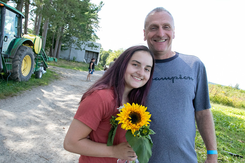 Lanni Orchards in Lunenburg held a Sunflower Festival on Saturday, August 31, 2019. The morning rush of people to see the sunflowers and get one was large so by the middle of the day not many sunflowers were left. Olivia Brindle, 18, and her dad Tony Brindle where lucky to find this one. SENTINEL & ENTERPRISE/JOHN LOVE