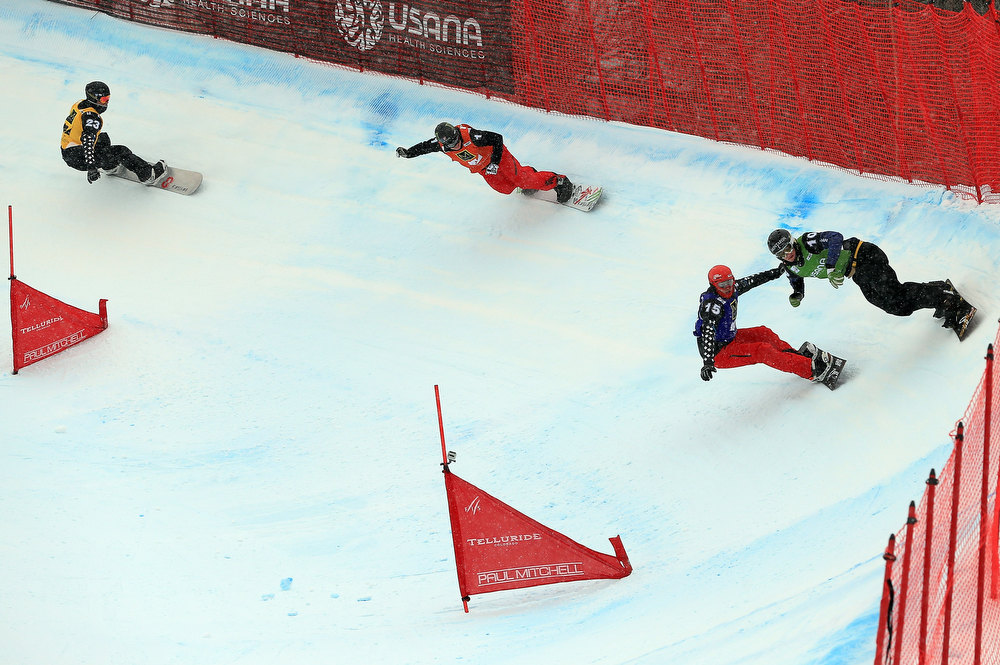 . (R-L) Alessandro Haemmerle of Austria, Christopher Robanske of Canada, Nate Holland of the USA and Robert Fagan of Canada descend the course during the semi finals of the USANA Snowboardcross World Cup Team Event on December 15, 2012 in Telluride, Colorado. Holland and teammate Seth Wescott went on to finish first overall. (Photo by Doug Pensinger/Getty Images)