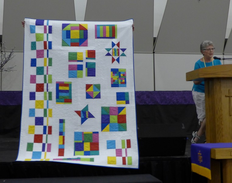 "Roseanne Brouwer showed us ""some sort of gypsy thing"".  She used a fat quarter packet called Radiance.  Nancy Boyse did the quilting"