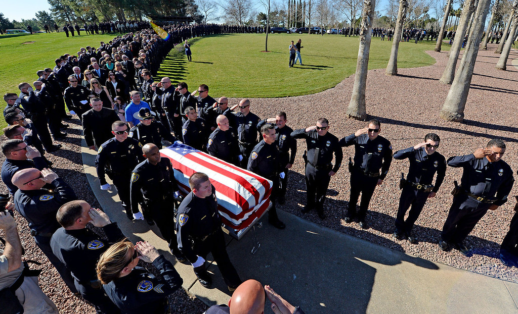 . Riverside police department officers salute as they line the walk as the casket of slain officer Michael Crain in brought in for services at Riverside National Cemetery Wednesday.  Funeral services for Riverside police officer Michael Crain February 13, 2013 at Riverside National Cemetery. Crain was killed February 7, Christopher Dorner is suspected in the shooting death of the officer. (Staff photo by Will Lester)