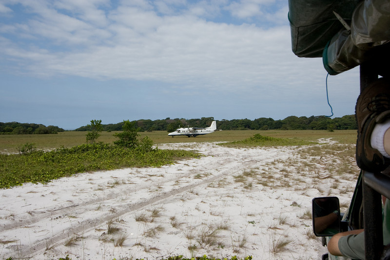 """Waiting at the """"airport"""" - we drove up in the Land Cruiser and waited while the plane landed, and stopped."""