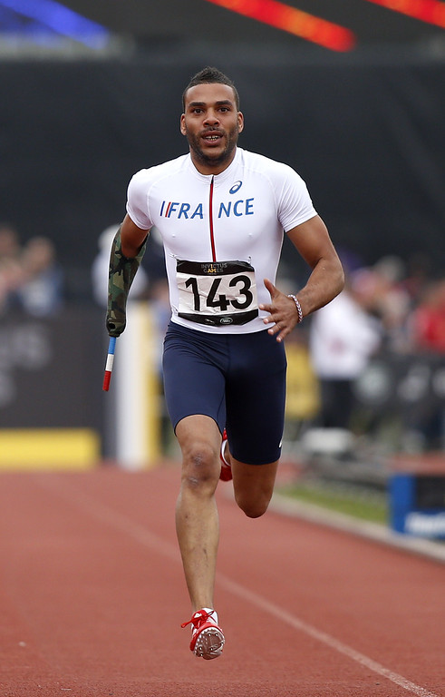 . France\'s Alain Akakpo competes in the 200m men ambulant IT3 during the athletics event of the Invictus Games at Queen Elizabeth II Park in London on September 11, 2014. AFP PHOTO/ADRIAN DENNISADRIAN DENNIS/AFP/Getty Images