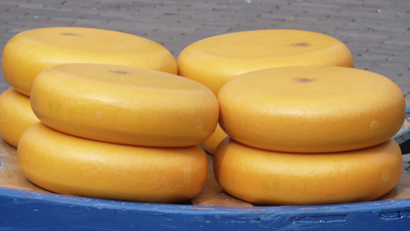 "Alkmaar. Gouda cheese (pronounced ""how-da"")"