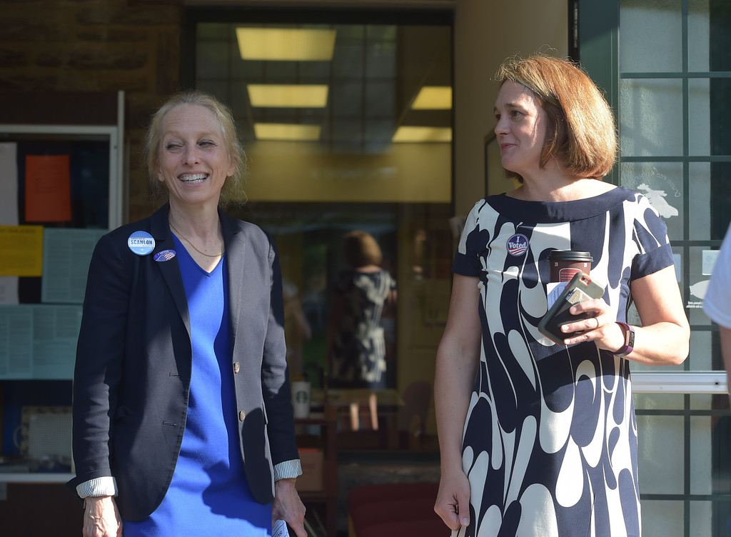 . PETE  BANNAN-DIGITAL FIRST MEDIA       Mary Gay Scanlon and Ashley Linkenheimer were both on hand at the Furness Library in Wallingford Tuesday morning to greet voters.  The two exchanged hugs before they left.