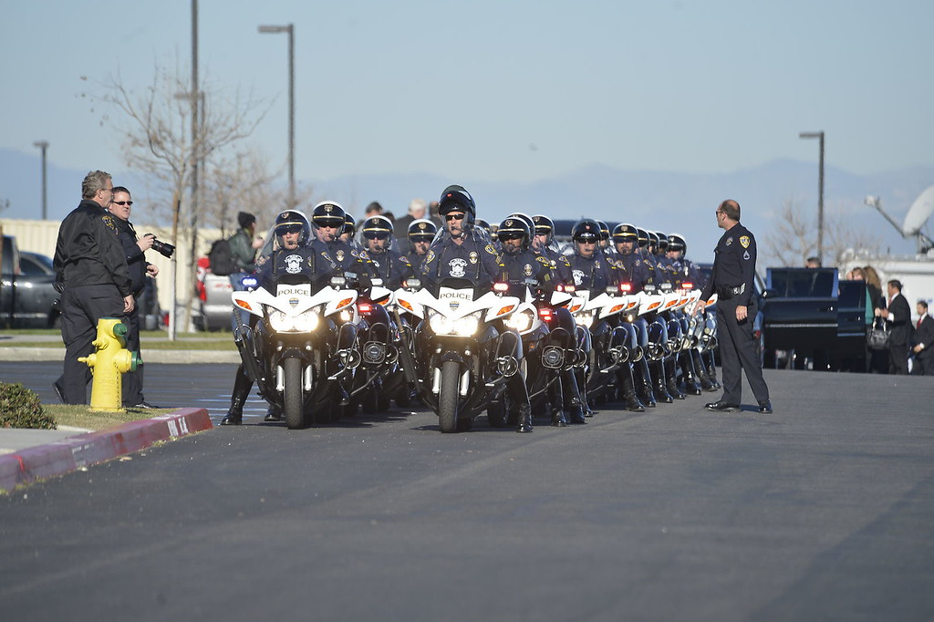 . Procession to Grove Community Church.  Today\'s funeral for fallen Riverside police Officer Michael Crain to draw thousands, including Gov. Jerry Brown.  The service, to be held at 10:30 a.m. at Grove Community Church, 19900 Grove Community Drive in Riverside, has increased security.  (Jeff Gritchen/Staff Photographer)