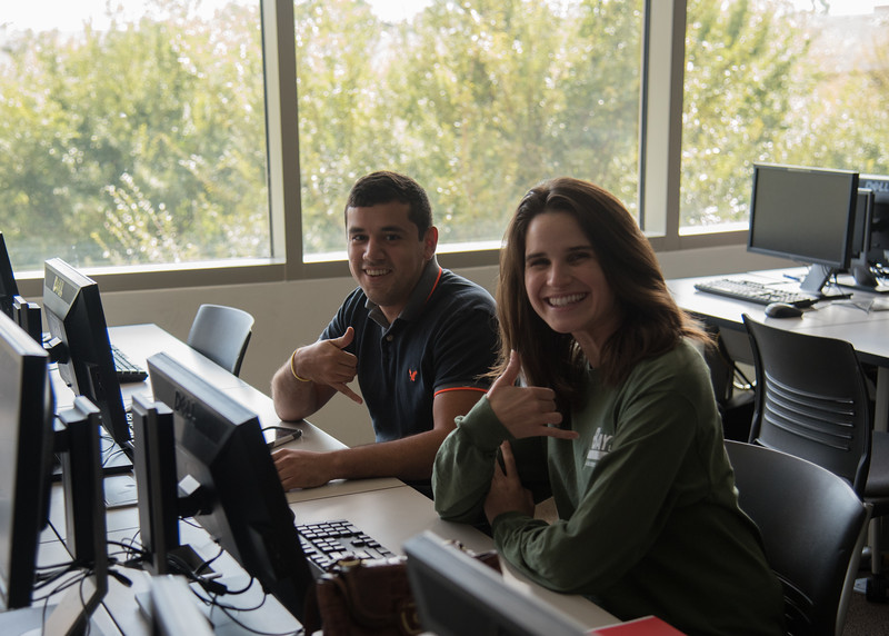 Students Roger Salazar II and Alexandra Murry take a break from their accounting homework.