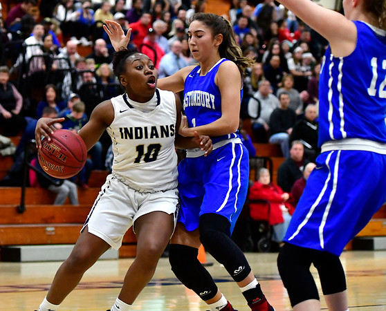 3/1/2019 Mike Orazzi | Staff Newington High School's Ashanti Frazier (10) and Glastonbury Tomahawks' Rachel Roman (1) during the Class LL Second Round of the CIAC 2019 State Girls Basketball Tournament at Newington High School Friday night.