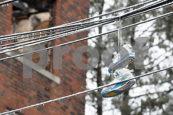 01/17/18 Wesley Bunnell   Staff The New Britain Fire Department battled a structure fire at 42 Connerton St. starting late on Tuesday night and continued into Wednesday morning. The building sustained severe damage with with interior structural collapse and a total roof collapse. One firefighter was injured and transported to the hospital for observation and released. Ice and sneakers hang from electrical wires leading to the building.