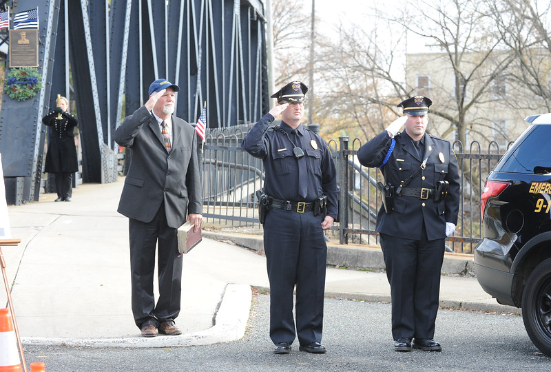 """The Rev. Randy Nelson, left, pastor of Phillipsburg Alliance Church, stands with Phillipsburg Police Chief, Robert Stettner and Sgt. James McDonald. The Phillipsburg Police Department held a remembrance ceremony honoring fallen officer, Kenneth W. """"Red"""" Vandegrift who died in the line of duty Nov. 20, 1930. The ceremony was at the bridge on South Main Street that bears his name."""