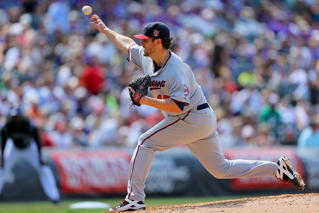 . Starting pitcher Phil Hughes #45 of the Minnesota Twins delivers to home plate during the fourth inning against the Colorado Rockies at Coors Field on July 13, 2014 in Denver, Colorado. The Twins defeated the Rockies 13-5. (Photo by Justin Edmonds/Getty Images)