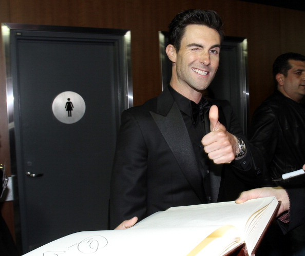 . LOS ANGELES, CA - FEBRUARY 10:  Singer Adam Levine of Maroon 5 poses with the GRAMMY Charities Signing Booth during the 55th Annual GRAMMY Awards at STAPLES Center on February 10, 2013 in Los Angeles, California.  (Photo by Maury Phillips/WireImage)