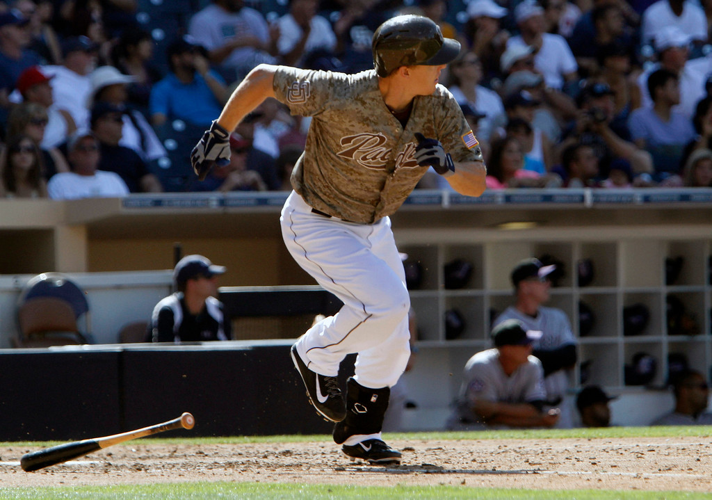 . San Diego Padres\' Nick Hundley runs after hitting a three-run RBI during the seventh inning against the Colorado Rockies during the baseball game on Sunday, Sept. 8, 2013, in San Diego. (AP Photo/Don Boomer)