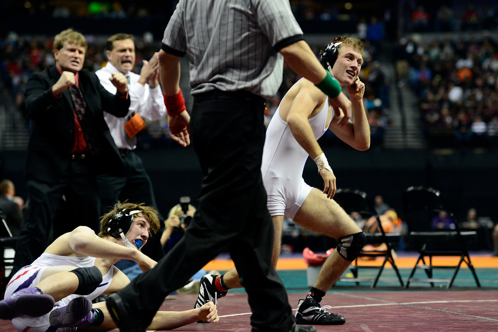 . DENVER, CO - FEBRUARY 23: Paonia 120-poumder Jesse Reed celebrates against Stetson Loader of Baca after a 7-5 win in the class 2A final during the Colorado State High School Wrestling Championships. The state\'s top wrestlers squared off in four classes in front of a near-capacity crowd at the Pepsi Center. (Photo by AAron Ontiveroz/The Denver Post)