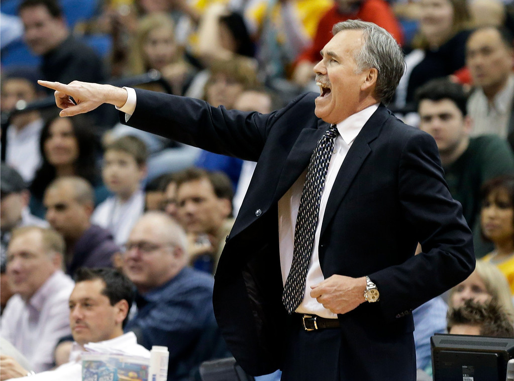 . Los Angeles Lakers head coach Mike D\'Antoni yells instructions in the second half of an NBA basketball game against the Minnesota Timberwolves on Wednesday, March 27, 2013 in Minneapolis. The Lakers won 120-117. (AP Photo/Jim Mone)