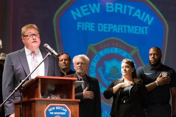 09/20/18 Wesley Bunnell | Staff The New Britain Fire Department held their 2018 Awards Ceremony on Thursday September 20 at Trinity on Main. H. Mark Neumann performs the National Anthem as Mayor Erin Stewart and Fire Board Tremell Collins stand to the right.
