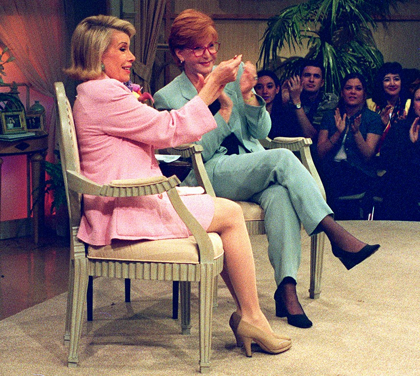 . Talk show titans Joan Rivers, left, and Sally Jessy Raphael chat with Raphael\'s audience during a taping of her show in New York, Tuesday, May 20, 1997.  Rivers and Raphael counseled audience members who feel immobilized because of their own personal tragedies.  The program is scheduled to air Monday, June 9, 1997.  (AP Photo/Lee Fryd)