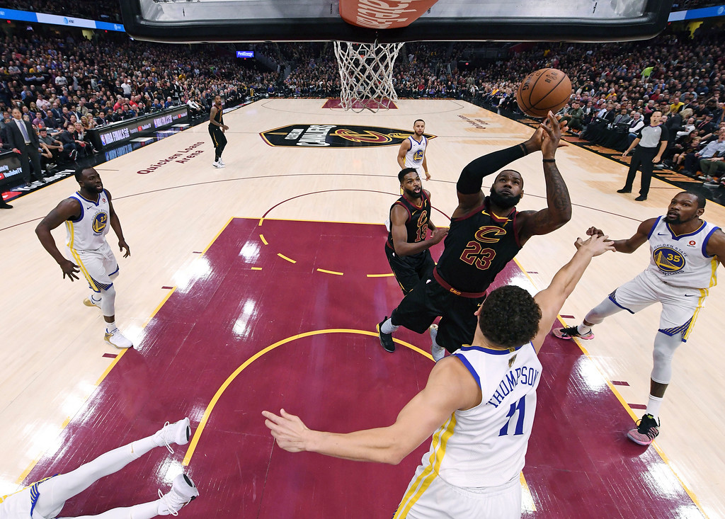 . Cleveland Cavaliers\' LeBron James (23) is defended by Golden State Warriors\' Klay Thompson in the first half of Game 3 of basketball\'s NBA Finals, Wednesday, June 6, 2018, in Cleveland. (Kyle Terada/Pool Photo via AP)