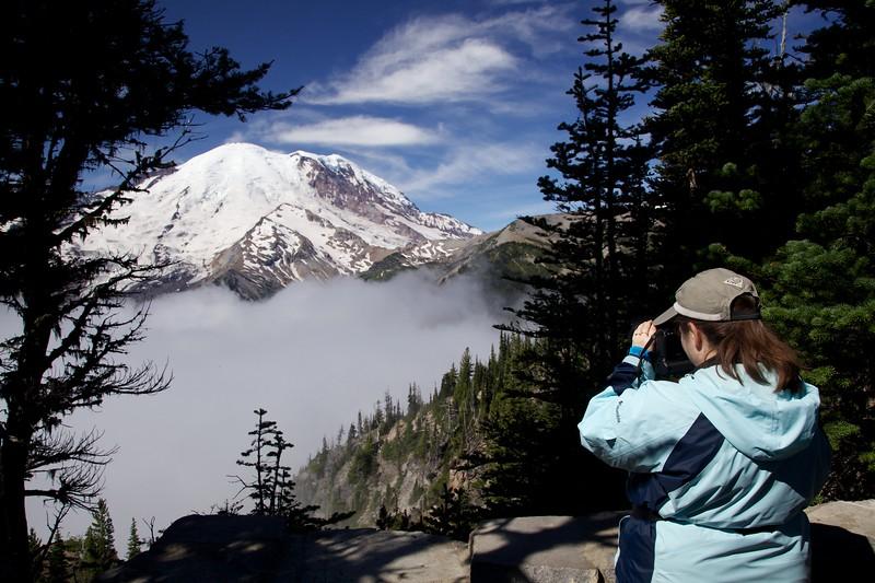 Beth taking photograph of Mount Rainier. Sunrise area, Mount Ranier National Park, Washington.