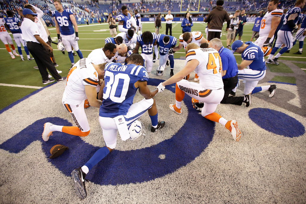 . Members of the Indianapolis Colts and Cleveland Browns pray following an NFL football game in Indianapolis, Sunday, Sept. 24, 2017. The Colts defeated the Browns 31-28. (AP Photo/AJ Mast)