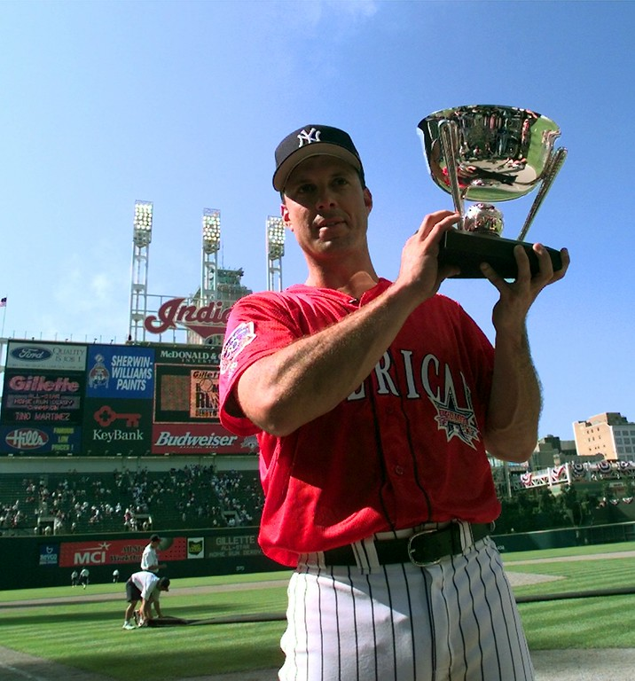 . New York Yankees\' Tino Martinez holds his trophy after winnning the Home Run Derby during All-Star game festivities Monday July 7, 1997 in Cleveland. Martinez won the event. (AP Photo/Beth Keiser)