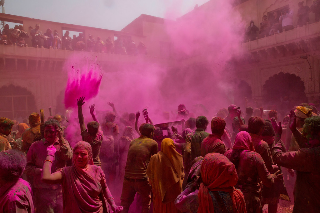 . Locals including widows, who were once forbidden, throw flower petals and colored powder during the arrival of spring festival called Holi at the Gopinath temple in Vrindavan, 180 kilometers (112 miles) south-east of New Delhi, India, Thursday, March 9, 2017. Up to just a few years ago the festival was forbidden for Hindu widows. Like hundreds of thousands of observant Hindu women, they would have been expected to live out their days in quiet worship, dressed only in white, with their very presence being considered inauspicious for all religious festivities. (AP Photo /Manish Swarup)