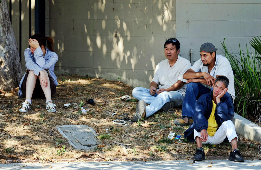 . Witnesses wait to interviewed by Los Angeles County Sheriff\'s officials after a shooting at a business where a man is found dead 10700 block of Weaver Avenue in South El Monte on Tuesday, June 18, 2013. (SGVN/Staff photo by Walt Mancini)