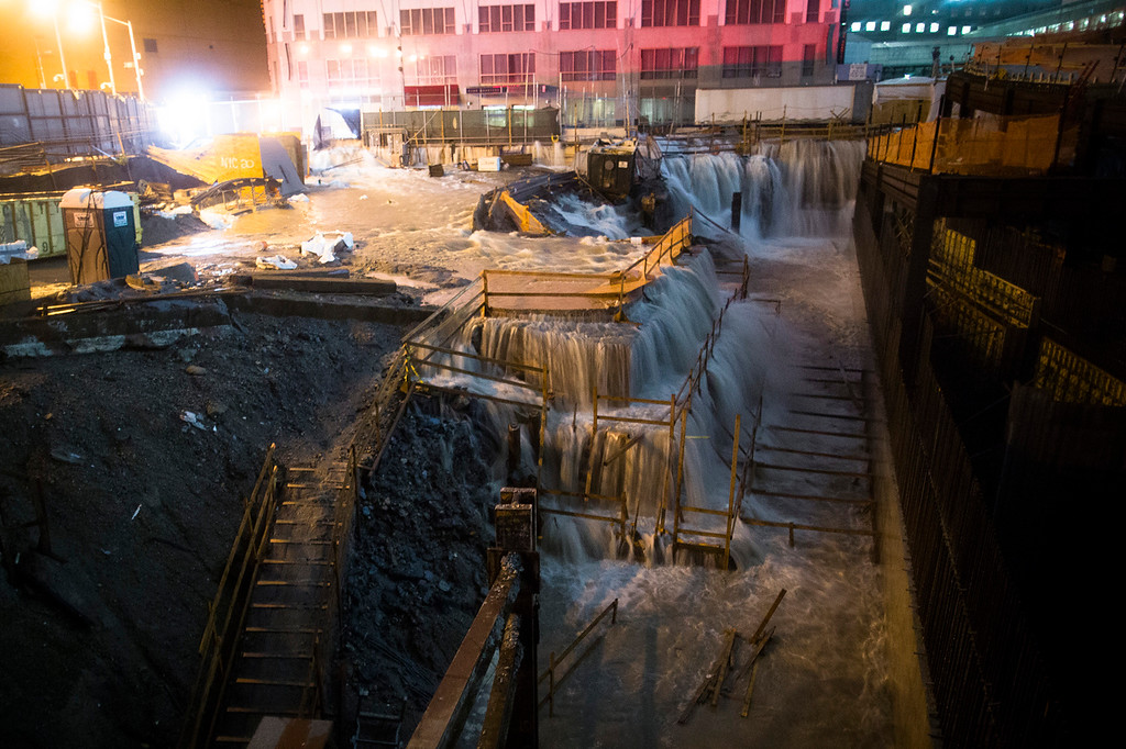 . Sea water floods the Ground Zero construction site, Monday, Oct. 29, 2012, in New York. Sandy continued on its path Monday, as the storm forced the shutdown of mass transit, schools and financial markets, sending coastal residents fleeing, and threatening a dangerous mix of high winds and soaking rain. (AP Photo/ John Minchillo)