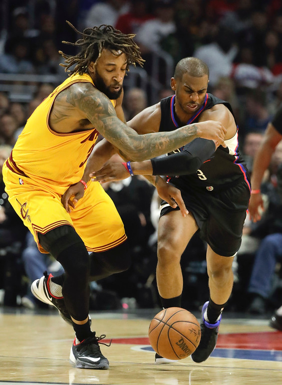 . Los Angeles Clippers\' Chris Paul, right, and Cleveland Cavaliers\' Derrick Williams go after the ball during the first half of an NBA basketball game Saturday, March 18, 2017, in Los Angeles. (AP Photo/Jae C. Hong)