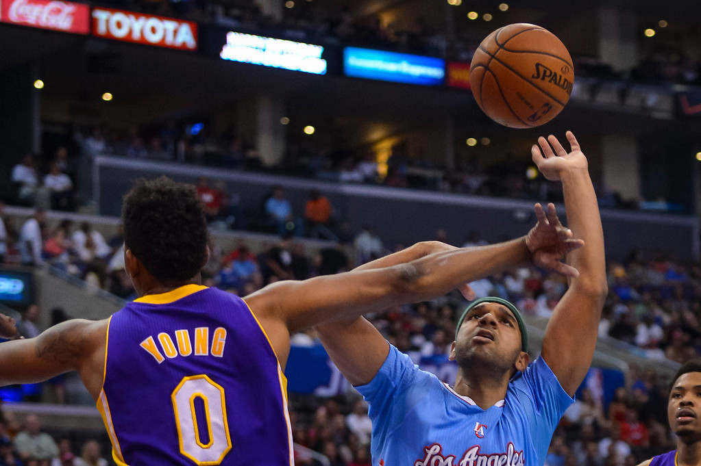 . Lakers� Nick Young and Clippers Jared Dudley go after a rebound  during game action at Staples Center Sunday April 6, 2014. Clippers defeated the Lakers 120-97.  ( Photo by David Crane/Los Angeles Daily News )